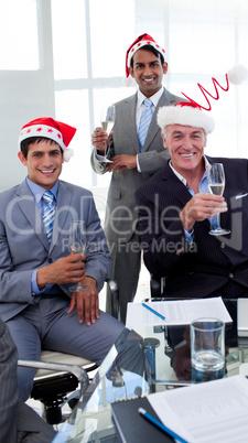 Confident businessmen wearing novelty Christmas hat