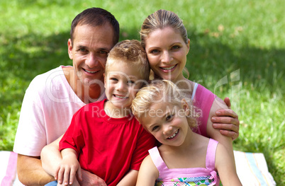 Close-up of a happy family smiling at the camera