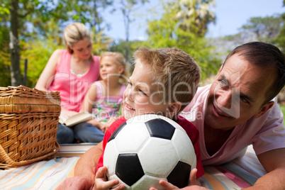 Happy family having fun at a picnic