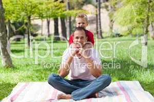 Father and his son having fun at a picnic