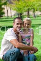 Smiling father and his daughter having a picnic