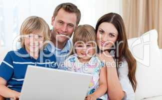 Young family surfing the internet