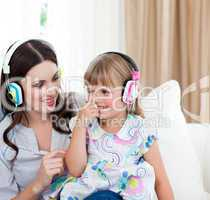 Portrait of a mother and her daughter listening music
