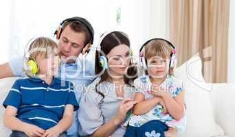 Young family listening music together