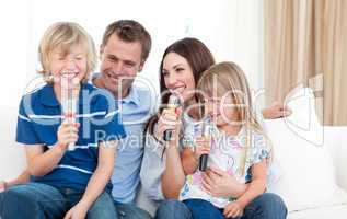Laughing family singing together