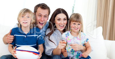 Happy family watching a rugby match