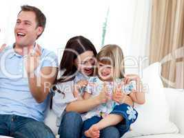 Happy family clapping a goal