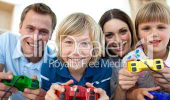 Smiling family playing video games together