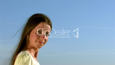 HD young woman smiling on a background of sky
