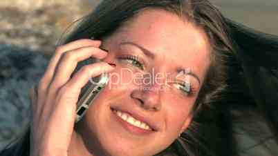 HD young woman speaking mobile phone on sunset