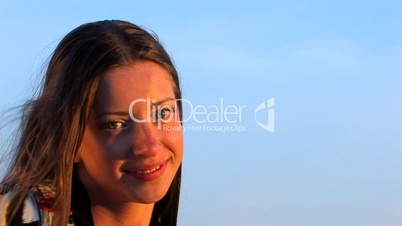 HD young woman smiling on sunset
