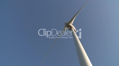 Wind power turbine detail on blue sky