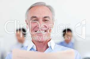 senior businessman reading