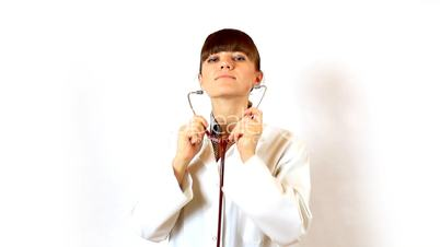 Young Female Doctor using a stethoscope