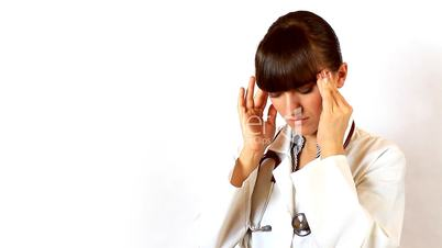 Young female doctor with a headache
