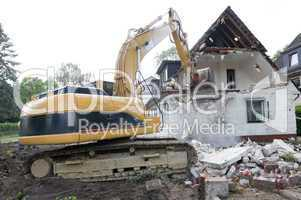 Digger demolishing house