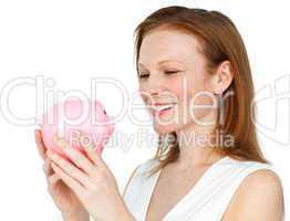 businesswoman holding a piggybank