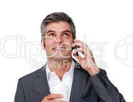 businessman on phone looking up
