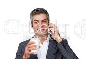 Businessman on phone drinking coffee