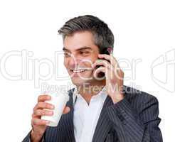 Businessman on phone and drinking a coffee