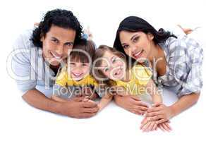Lively family lying on the floor