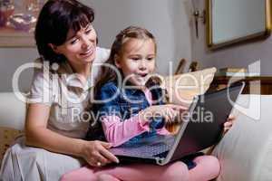 daughter and mom surfing internet