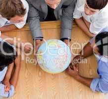 business people looking at a globe