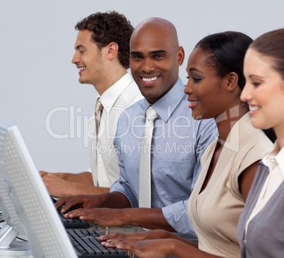 Ethnic businessman sitting in a row with his team