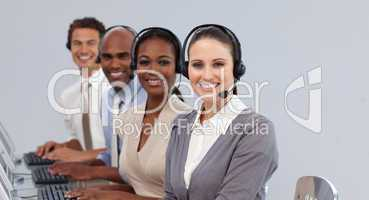 Young business people with headset on smiling at the camera