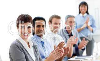 Multi-ethnic business people clapping a good presentation