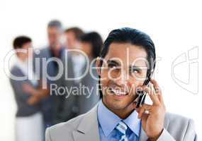 Focus on a smiling businessman on phone