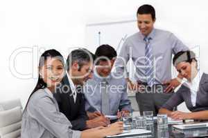 Confident young businessman presenting to his team