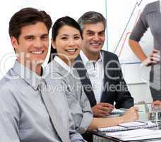 Confident business people at a presentation