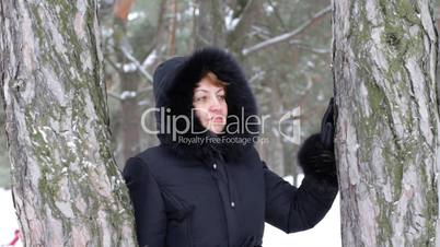 woman with smile in winter wood.