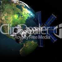Satelite sputnik orbiting earth