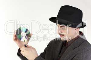 Man in hat burning a compact disc