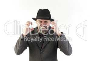 Man in hat biting a compact disc
