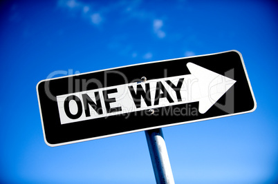 One Way Sign with blue sky
