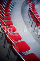 Perfect rows of red chairs