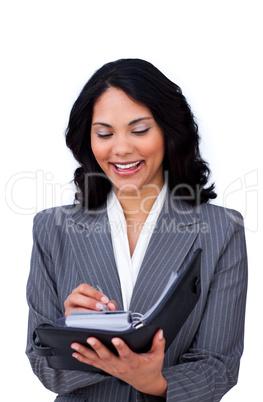 Ethnic businesswoman making notes on her agenda