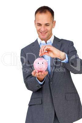 Charismatic businessman saving money in a piggybank