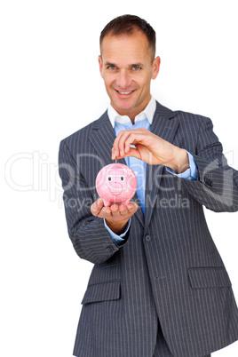 Confident businessman saving money in a piggybank