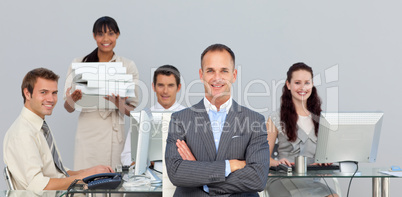 Self-assured manager with folded arms with his team