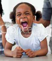 Angry little girl shouting