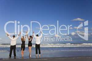 Four Young People, Two Couples, Arms Up Celebrating On Beach