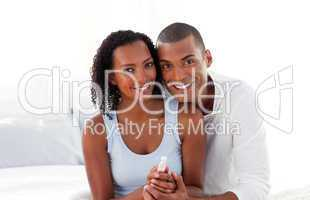 Jolly couple finding out results of a pregnancy test