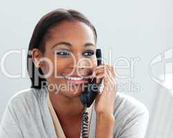 Close-up of a confident businesswoman on phone