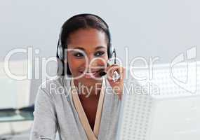 Assertive ethnic customer service agent with headset on