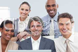 Charismatic International business people using a laptop