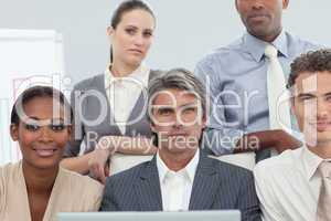 Cocentrated diverse business people working at a laptop